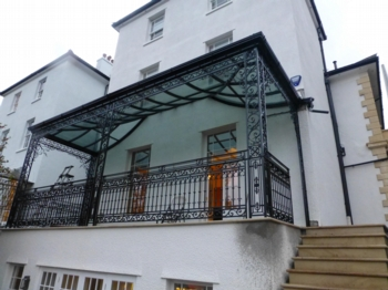 Covered regency style balcony with concave uv glazing peter weldon iron designs ltd - Houses with covered balconies ...