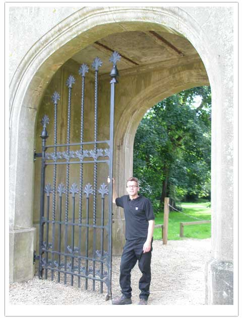 Peter Weldon standing by the replica Knebworth Gates