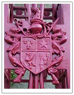 Photograph of a coat of arms on the gate
