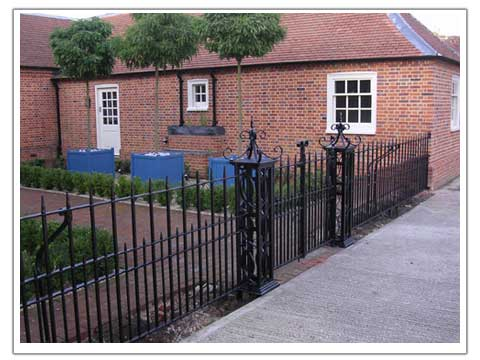 Photo of a courtyard railing and gate